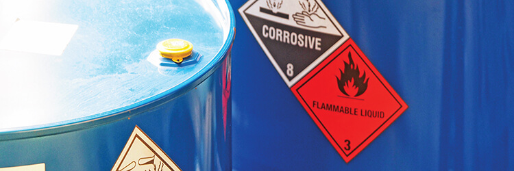 Close up of blue chemical barrels.