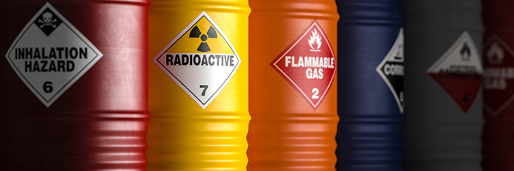 Colored chemical barrels with labels.