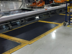 SPC Industrial mats being used on an assembly line.